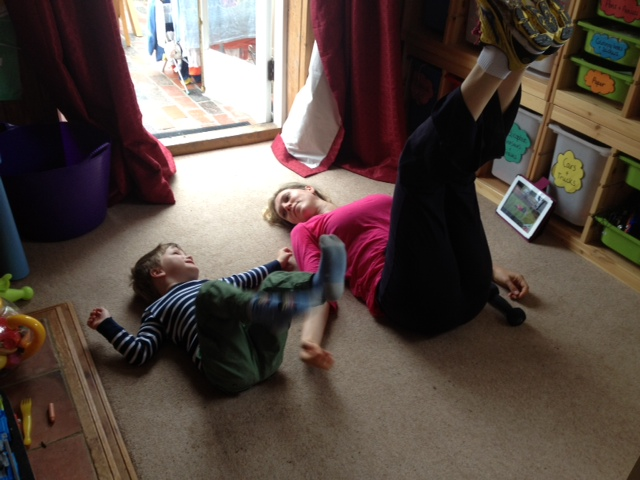 Janey and child exercising