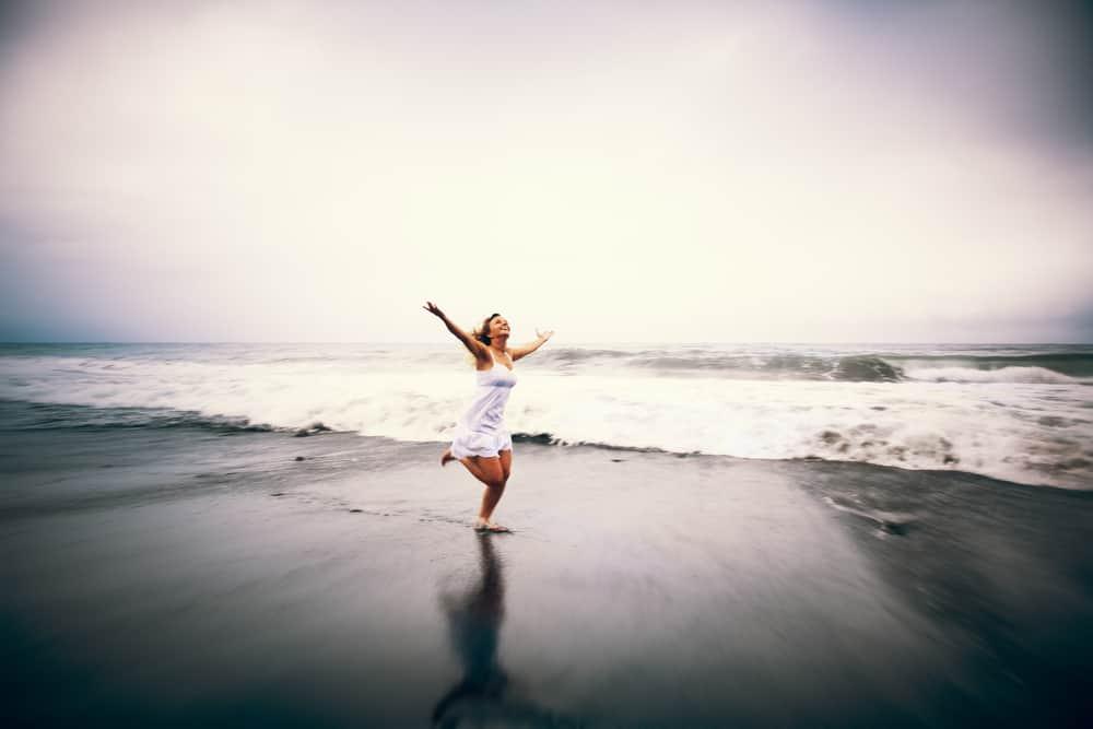 Freedom – lady on beach B&W